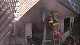 Crews work to douse U-Place fire - (4/10)