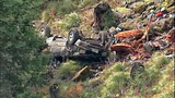 Truck flips dozens of times down steep hillside - (14/15)