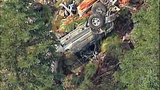 Truck flips dozens of times down steep hillside - (1/15)