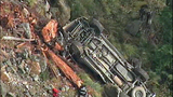 Truck flips dozens of times down steep hillside - (9/15)