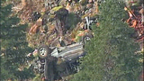 Truck flips dozens of times down steep hillside - (7/15)