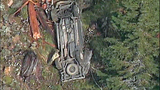 Truck flips dozens of times down steep hillside - (2/15)