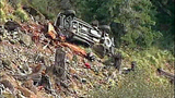 Truck flips dozens of times down steep hillside - (13/15)