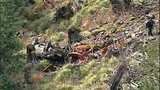 Truck flips dozens of times down steep hillside - (8/15)
