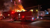 Flames swallow apartments, businesses - (8/20)