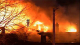 Flames swallow apartments, businesses - (3/20)