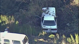 Car careens off road, crashes in ravine - (1/8)