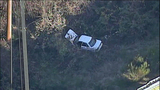 Car careens off road, crashes in ravine - (5/8)