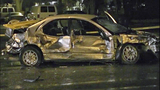 Car a twisted heap after violent impact - (4/16)