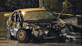 Car a twisted heap after violent impact - (2/16)