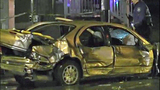 Car a twisted heap after violent impact - (11/16)