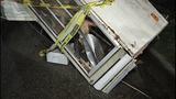 Trailer a mess of glass shards, splinters - (2/12)