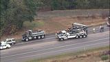 Overturned dump truck spills dirt across highway - (4/18)