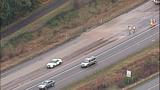 Overturned dump truck spills dirt across highway - (11/18)