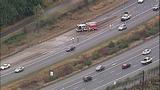 Overturned dump truck spills dirt across highway - (8/18)