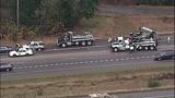 Overturned dump truck spills dirt across highway - (16/18)