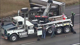Overturned dump truck spills dirt across highway - (3/18)