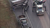 Overturned dump truck spills dirt across highway - (5/18)