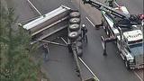 Overturned dump truck spills dirt across highway - (14/18)