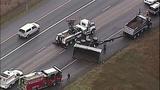 Overturned dump truck spills dirt across highway - (15/18)