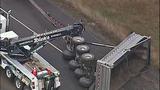 Overturned dump truck spills dirt across highway - (7/18)