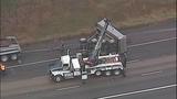Overturned dump truck spills dirt across highway - (13/18)