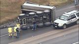 Overturned dump truck spills dirt across highway - (2/18)