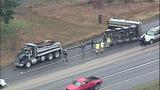 Overturned dump truck spills dirt across highway - (10/18)