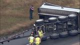 Overturned dump truck spills dirt across highway - (17/18)