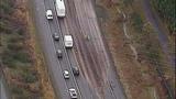Overturned dump truck spills dirt across highway - (12/18)