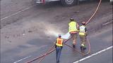 Overturned dump truck spills dirt across highway - (6/18)