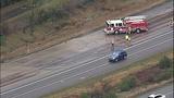 Overturned dump truck spills dirt across highway - (9/18)
