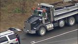 Overturned dump truck spills dirt across highway - (18/18)