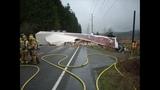 Semi truck crumbles, load spills in crash - (4/4)