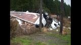Semi truck crumbles, load spills in crash - (1/4)