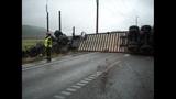 Semi truck crumbles, load spills in crash - (2/4)
