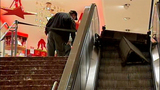 Escalator failure shocks holiday shoppers - (1/10)