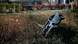 Car goes airborne into river in fatal crash - (5/8)