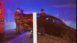 Tire ripped off car in mystery rollover crash - (1/6)