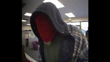 Red-masked bank robber caught on camera - (2/3)
