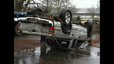 Truck battered after flight into river - (1/3)