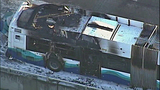 Remains of bus a charred, foamy hulk - (2/12)
