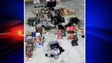 Stolen guns, other goods crammed in SUV - (2/13)