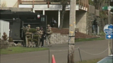 PHOTOS: SWAT team surrounds killer - (1/16)