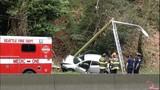 Car collides into pole south of Aurora Bridge - (1/3)