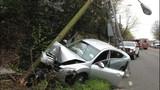 Car collides into pole south of Aurora Bridge - (2/3)