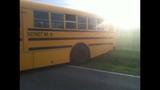 PHOTOS: Wilson High School bus stuck in ditch - (3/4)