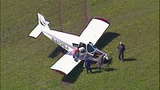 Small plane crash lands in cow pasture - (4/10)