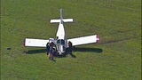 Small plane crash lands in cow pasture - (3/10)
