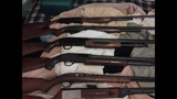 PHOTOS: Police find guns, marijuana, pot… - (5/7)